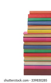 Pile of books with covers of different colors on a white background, isolate.