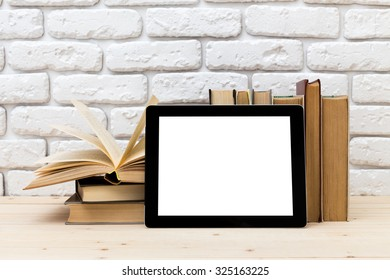 A pile of books and digital tablet