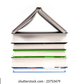 Pile of books having the shape of house on thw white background