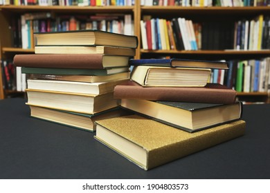 A pile of books on a desk in the school library