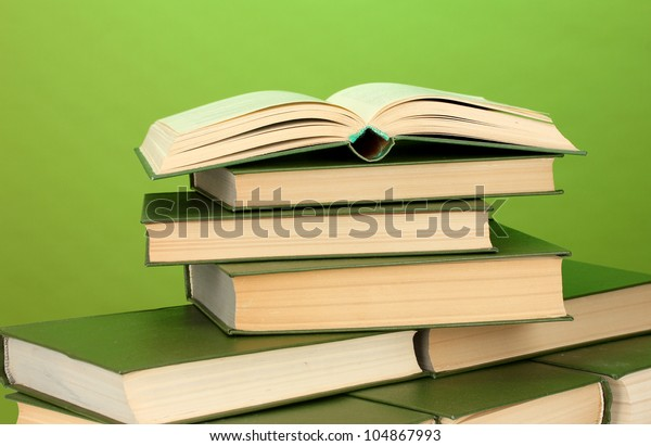 pile of books on green background close-up