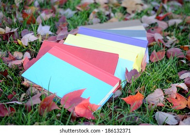 A pile of books on lawn in autumn season