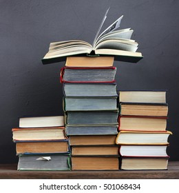 Pile of books on a table. Open book. Education, back to school. Library.