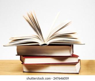 A pile of books on table and white background