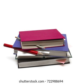 Pile of books, pencils and leaflets for records. On a white background
