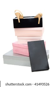 Pile of boxes and woman high-heeled shoes over white