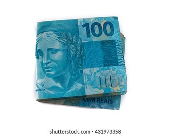 Pile of Brazilian 100 currency (reais).