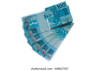 Pile of Brazilian 100 currency (reais). White Background, Horizontal.