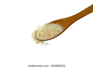 Pile of breadcrumbs in a wooden spoon isolated on white background