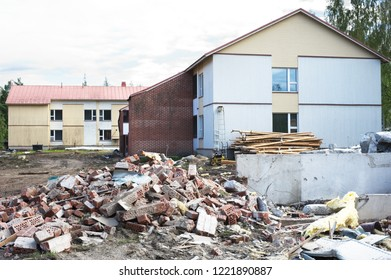 Pile of brick debris at a building demolition site. Construction waste recycling.
