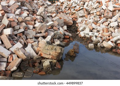 pile of bricks destroyed after a natural disaster.