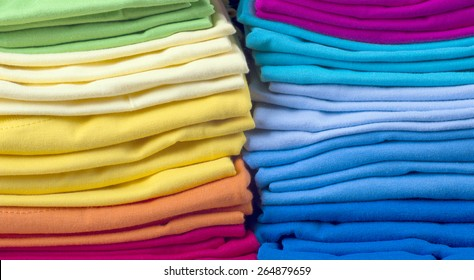 Pile of bright folded clothes.t-shirts