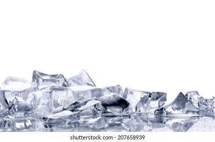 pile of  bright ice cubes on reflection surface on  white background