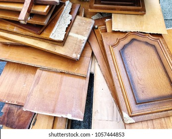 pile of broken cabinet doors