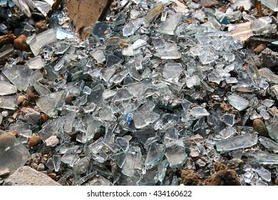 A pile of broken glass in a landfill. Hazardous waste