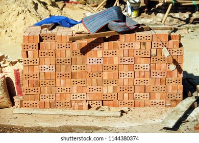 Pile of brown bricks in suburb construction site for reapairing and build buildings