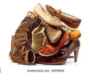 Pile of brown female shoes isolated on white background
