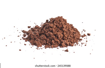 Pile of the brown ground soil isolated over the white background