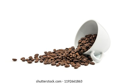 Pile of brown roasted coffee beans  in coffee cup spill on white background.Freshness or great aroma and energy concept.Free space.