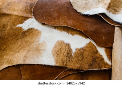 Pile brown rug cow leather.