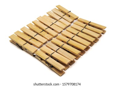 Pile of Brown wood clothes peg or clothespin made from bamboo isolated on white background