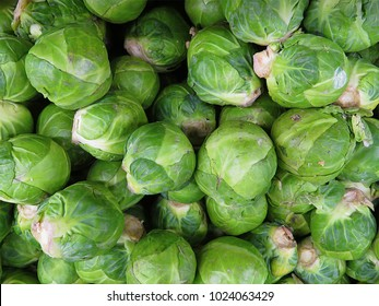 A pile of Brussel Sprouts, close up and filling the frame.