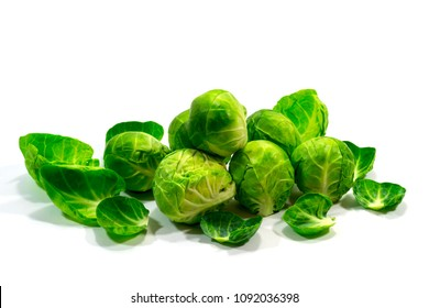 pile of brussels sprouts on white background