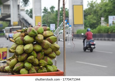 pile or bunch of coconuts on the cart at road for sells in india, hyderabad