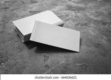 Pile of business cards on grey background