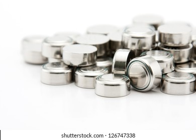 pile of button cell batteries macro, on white background