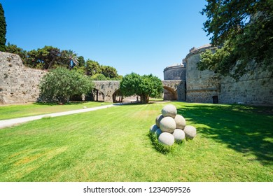 Pile of cannonballs next to Grand master palace in old town of Rhodes (Rhodes, Greece)