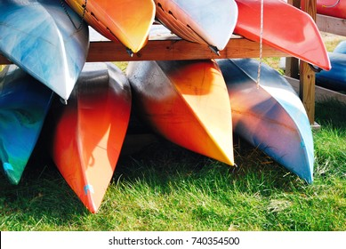 Pile of canoe, bright beautiful colored canoes