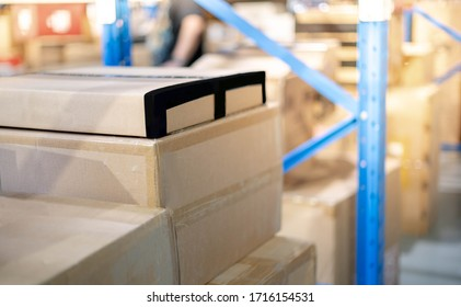 A pile of cardboard box parcel prepare to put on the shelf or blue metal rack  installed in warehouse or stockhouse, The parcel preparing for shipping to customer.