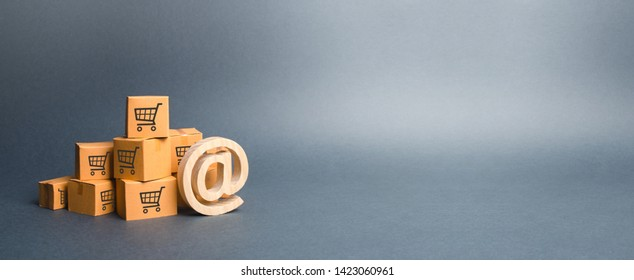 Pile of cardboard boxes and email symbol commercial AT. Promotion of goods through social networks and direct advertising. shopping online. E-commerce. online trading platforms. banner, copy space