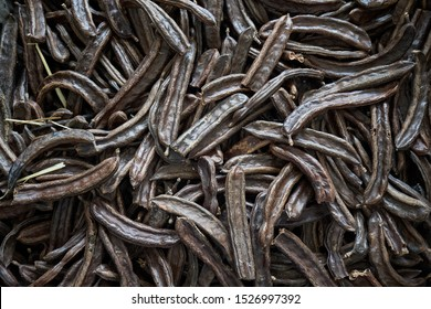 Pile of carob beans for background