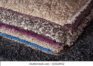 pile of carpets of different colors