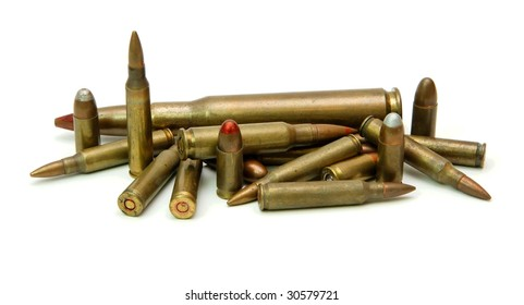 Pile of cartridges of various calibers isolated