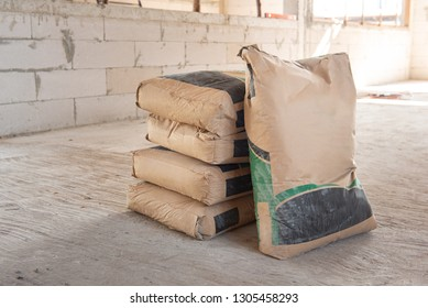 Pile of Cement in bags, stacked for a construction project.