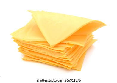 a pile of cheese slices isolated on white