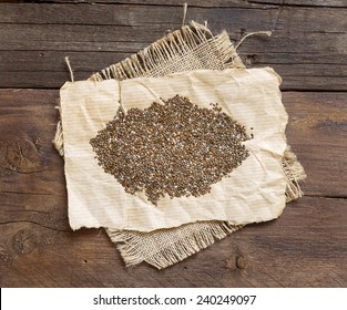 Pile of chia seeds on a rustic background