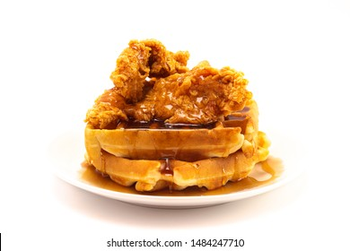 A Pile of Chicken and Waffles Isolated on a White Background