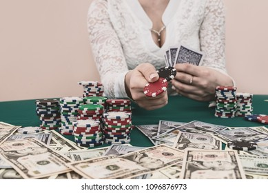 Pile of chips in female hands ready to make bet