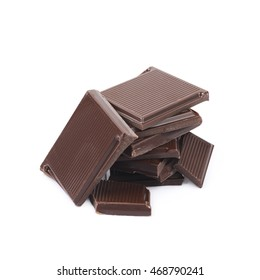Pile of chocolate bar pieces isolated over the white background