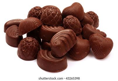 Pile of chocolate bonbons isolated on white