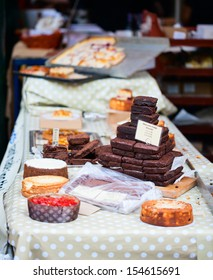 Pile of chocolate brownies and cakes at market