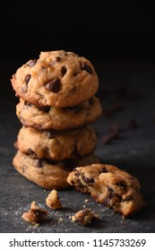 Pile of Chocolate Chip Cookies on a Dark Background
