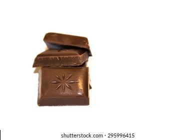 Pile Of Chocolate On Simple White Background