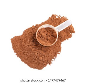 Pile of chocolate protein powder and scoop isolated on white, top view