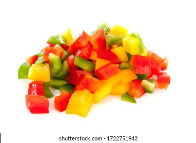 Pile of chopped fresh paprika in several colors over white background