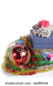 A pile of Christmas ball and gifts isolated on white background.